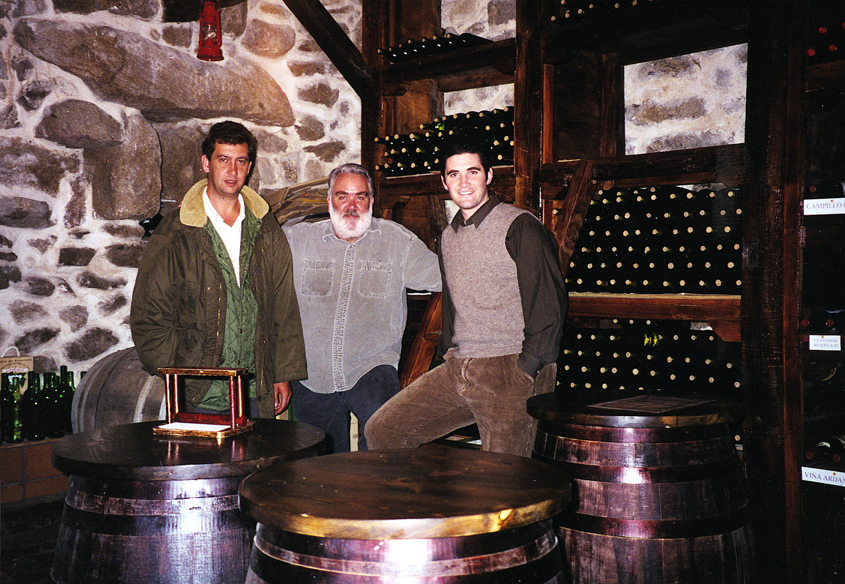 Clint, Marcos and Sean in the wine cellar of a manor house